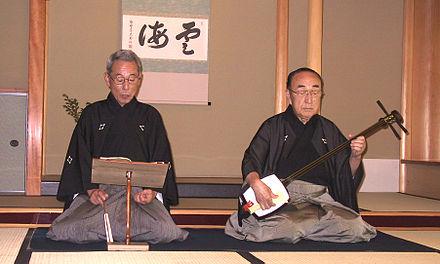 Bunraku, Tayu (Rezitator) und Samisen-Spieler (zu: Jacques Lacan, Lituraterre - Buchstabe vs. Signifikant)
